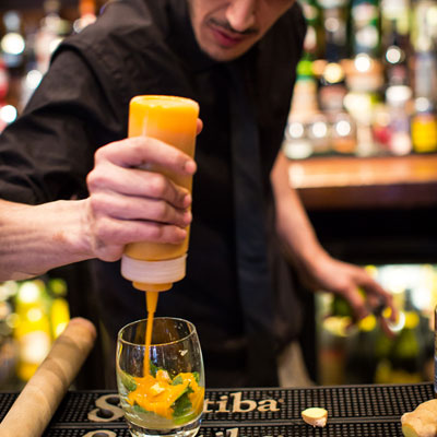 cocktail drink being made by bar staff